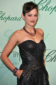 Marion Cotillard attended the Chopard 150th anniversary party wearing a colorful cuff bracelet by Atelier Minyon.