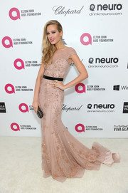When Sir Elton John throws a party, beautifully dressed supermodels come out to play. Case in point: the lovely Petra Nemcova. At the 22nd Annual Elton John AIDS Foundation Academy Awards viewing party with Chopard, Nemcova took the skin-tone embellished gown trend to new heights of glamour with her stunning, floor-length number that radiated femininity.
