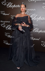 Rihanna layered a black tulle coat over her gown for a more dramatic finish.