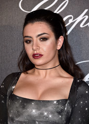 Charli XCX styled her locks into a classic half-up 'do for the Chopard Gent's Party.