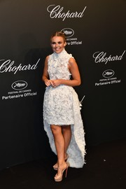 Tallia Storm brought some bridal glamour to the Chopard Space Party with this floral-embroidered high-low dress.