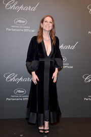 Julianne Moore looked bold in a deep-V, dual-textured black dress by Alexander McQueen at the Chopard Space Party.