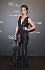 Paz Vega went the '70s-chic route in a sheer-striped bell-bottom jumpsuit by Elie Saab at the Chopard Space Party.