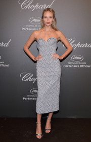 Natasha Poly finished off her look with silver ankle-strap sandals.
