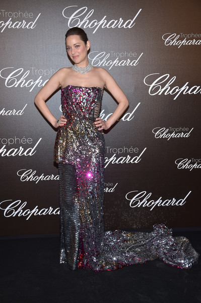 Marion Cotillard was easily the star of the show thanks to this mega-sequined hybrid gown by Halpern at the Chopard Trophy photocall.