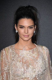 Kendall Jenner looked edgy with her teased ponytail at the Chopard Wild Party.