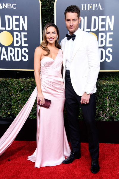 Chrishell Stause Velvet Clutch [flooring,carpet,shoulder,formal wear,red carpet,gown,fashion,suit,girl,cocktail dress,arrivals,chrishell stause,justin hartley,beverly hills,california,the beverly hilton hotel,l,golden globe awards]