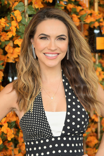 Chrishell Stause Long Wavy Cut [hair,hairstyle,polka dot,beauty,orange,long hair,pattern,blond,lip,design,chrishell stause,los angeles,pacific palisades,california,will rogers state historic park,veuve clicquot polo classic]