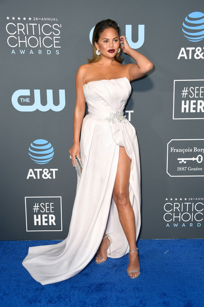 Chrissy Teigen Strapless Dress [flooring,gown,fashion model,shoulder,carpet,joint,cocktail dress,leg,red carpet,model,arrivals,chrissy teigen,critics choice awards,santa monica,california,barker hangar]