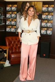 Chrissy Teigen was business-chic in a cream-colored blazer by Magda Butrym during her book signing.