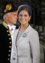 Princess Madeleine chose to accessorize with a stark purple fascinator as she attended the christening of the new Swedish Heir, Princess Elle.
