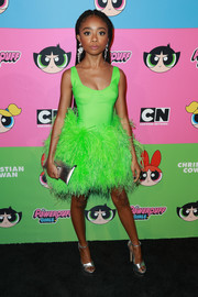 Skai Jackson went fun and flirty in a neon-green corset dress with a feathered skirt at the Christian Cowan x The Powerpuff Girls show.