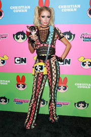Paris Hilton arrived for the Christian Cowan x The Powerpuff Girls show wearing a colorful star-print top.
