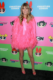 Heidi Klum worked a hot-pink feathered hoodie at the Christian Cowan x The Powerpuff Girls show.