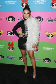 Francia Raisa rocked a two-tone feathered mini dress at the Christian Cowan x The Powerpuff Girls show.