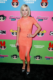 Carly Rae Jepsen attended the Christian Cowan x The Powerpuff Girls show wearing a studded, body-con orange dress.