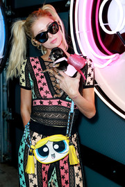 Paris Hilton looked chic in her butterfly sunnies at the Christian Cowan x The Powerpuff Girls show.
