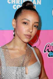 Tinashe attended the Christian Cowan x The Powerpuff Girls show wearing her hair in a top bun.