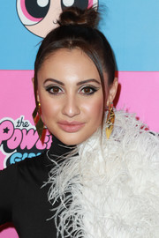 Francia Raisa styled her hair into a top knot for the Christian Cowan x The Powerpuff Girls show.