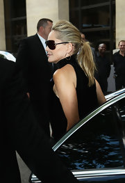 Sharon Stone wrapped her voluminous ponytail in her own hair for this ultra-chic look at the Dior show in Paris.