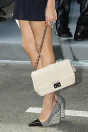 Olivia carried this studded chain-strap bag with her eclectic ensemble at the Dior show in Paris.