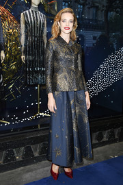 Natalia Vodianova looked regal in a navy cosmic-print skirt suit by Dior during the brand's 70 Years of Creation celebration.