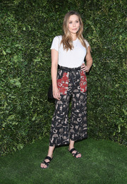 Elizabeth Olsen kept it super laid-back in a plain white tee at the Christian Dior '70 Years of Creation' exhibition.