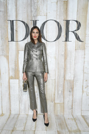 Alexa Chung shimmered in a silver Dior suit during the label's Cruise 2019 show.