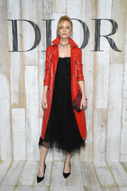 Daria Strokous amped up the chic factor with a red leather trenchcoat, also by Dior.