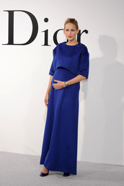 Leelee Sobieski exuded minimalist elegance in a blue Dior crop-top and a matching long dress during the label's Cruise 2015 show.