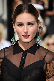 Olivia Palermo had a powerful red pout at the Christian Dior spring/summer 2012 fashion show. To recreate her bright look try Covergirl LipPerfection Lipcolor in Hot.