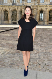 Marion Cotillard's blue Christian Dior velvet ankle boots added a quirky touch to her look.