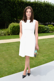Chiara Mastroianni went the minimalist route in this sleeveless LWD during the Dior Couture fashion show.