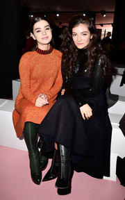 Lorde teamed mid-calf boots with a little black dress for the Dior Fall 2015 show.