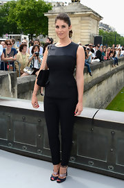 Gemma chose a sleeveless, fitted black top to pair with black skinny pants for a monochromatic look.