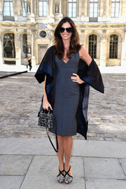 Christina Pitanguy showed off her slim figure in a tight gray dress during the Christian Dior fashion show.