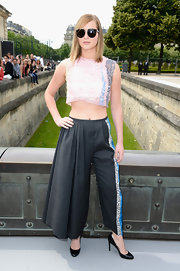 Jennifer Lawrence looked sporty but chic in this pink cropped top, which she paired with wide-legged pleated pants.