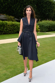 Christina Pitanguy kept it simple yet classic in a sleeveless navy shirtdress during the Dior Couture fashion show.