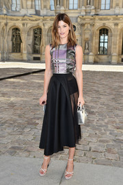 Hanneli Mustaparta shimmered in a metallic plaid top by Christian Dior during the label's fashion show.