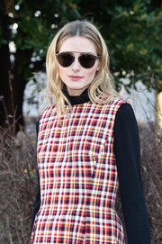 Olivia Palermo arrived for the Dior Couture fashion show wearing a pair of So Real sunglasses from the label.