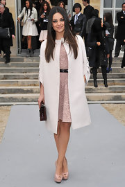 Mila Kunis perfected a lacy pink dress at the Dior show with the brand's chic white collarless coat.