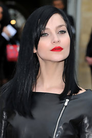 Leigh Lezark attended the Christian Dior fall 2012 fashion show wearing fiery red lipstick.