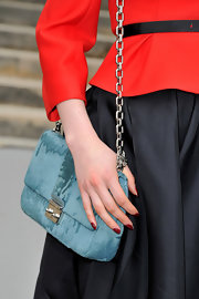 Tali Lennox wore a chain strap bag during Paris Fashion Week.