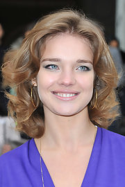Natalia Vodianova wore her layered cut in soft waves and curls at the Christian Dior fall 2012 fashion show.