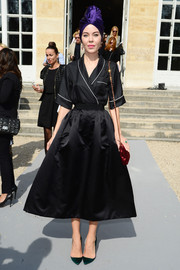 Ulyana Sergeenko's flared black satin skirt lent a '50s vibe to her look.