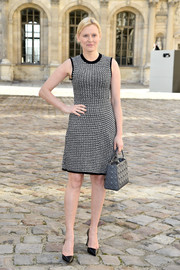 Anna Sherbinina looked mod at the Christian Dior fashion show in a black-and-white patterned dress.