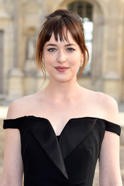 Dakota Johnson pulled her hair up into a messy-sexy French twist for the Christian Dior fashion show.