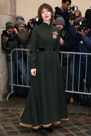Ulyana Sergeenko was equal parts tough and classy in a military-inspired fur-trimmed coat at the Dior Couture show.