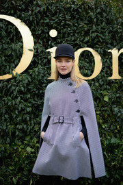Natalia Vodianova attended the Christian Dior Haute Couture show wearing a houndstooth cape dress from the label.