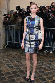 Kate Bosworth donned a metallic plaid top by Christian Dior for the label's fashion show.